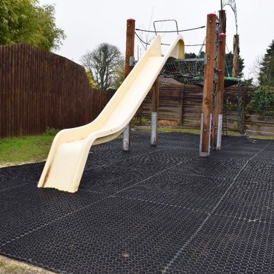 Rubber grass mats used under slide